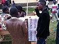 Electeurs devant un bulletin de vote pour les deputés au CV de KASENGA (6435248709).jpg