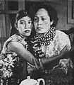 Endang Kusdiningsih and Fifi Young in Tarmina, Film Varia 2.6 (Jun 1955), p44.jpg