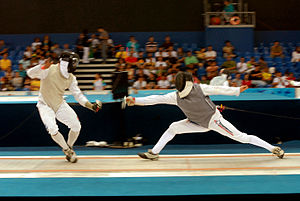 Lamé (fencing) - Foil fencers wearing different colored lamés