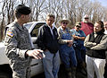 FEMA - 34603 - Arkansas Governor Mike Beebe meets with local and state officials in the field.jpg