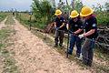 FEMA - 44227 - AmeriCorps Members Repair Fence in Holmes County, MS.jpg