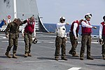 FOD Walk on the USS Green Baya 150308-M-CX588-024.jpg