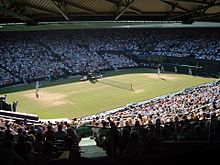 Federer serve wide view Wimbledon 2006.JPG
