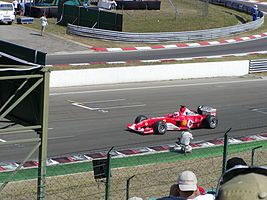 Ferrari driving to start grid at the 2003 Hungarian Grand Prix.jpg