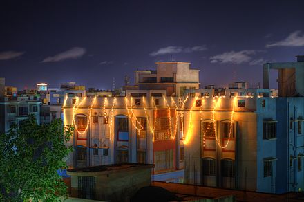 Homes, such as above, and buildings are decorated with festive lights for Diwali.[50] - Diwali