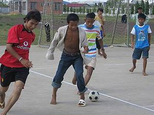 Young Cambodian boys playing soccer