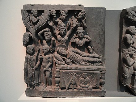 On the left: Mahakasyapa meets an Ajivika and learns of the parinirvana Four Scenes from the Life of the Buddha - Parinirvana - Kushan dynasty, late 2nd to early 3rd century AD, Gandhara, schist - Freer Gallery of Art - DSC05119.JPG