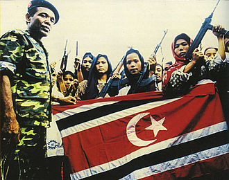 Aceh - Women soldiers of the Free Aceh Movement with GAM commander Abdullah Syafei'i, 1999