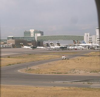 Frontier Airlines - Denver International Airport's Pedestrian Bridge, with many Frontier and Lynx Aviation aircraft in the foreground