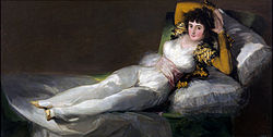 The Clothed Maja, about 1803.These two paintings have a shared history. The Nude Maja was painted first and met with public outcry upon release. Instead of painting over his work, Goya created The Clothed Maja, a separate painting. The two are held by the Museo del Prado and are usually displayed together.