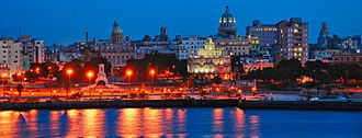 Havana Harbor - The waters of Havana Harbor, showing Old Havana at night.
