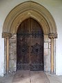 Harlaxton Ss Mary and Peter - exterior Nave south door.jpg