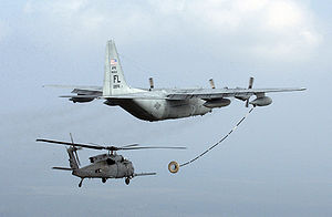 "920th Rescue Wing - One of the 920th Rescue Wing's HC-130P Hercules ""Combat King"" aircraft refuels one of the wing's HH-60G Pave Hawk helicopters."