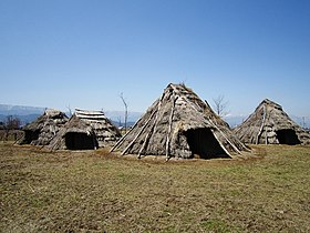 Hira-ide Historic Site Park reconstructed Jomon period (3000 BC) houses.jpg