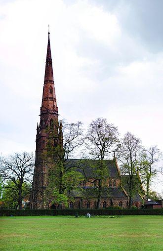 Platt Fields Park - Church of the Holy Trinity from Platt Fields Park