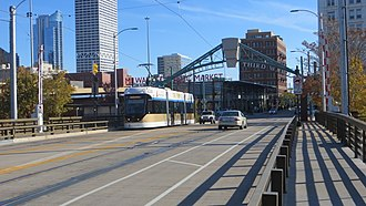 The Hop (streetcar) - A streetcar crossing the St. Paul Avenue Bridge over the Milwaukee River