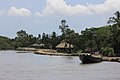 Houses of Sonagar village right behind the dam at the edge of Sundarbans National Park in India.jpg