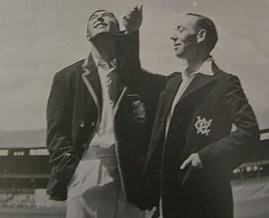 Lindsay Hassett - Hassett (right) tosses for innings with Denis Compton at the MCG during the 1950–51 season