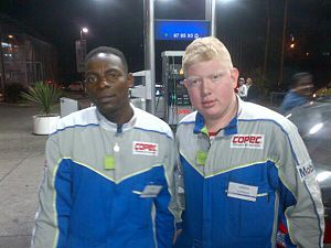 Immigration to Chile - Colombian immigrant (left) with a coworker working in a gas station in Antofagasta, Chile.