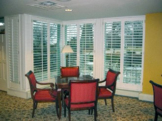 Window shutter - Interior plantation style wood window shutters with open louvers