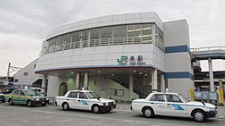 JREast-Joban-line-Izumi-station-entrance-south-20131226-155138.jpg