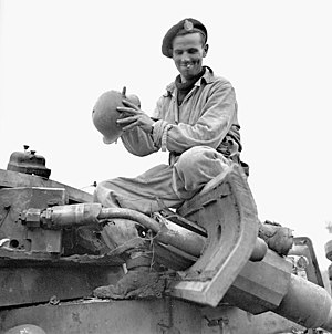 12e Régiment blindé du Canada - Trooper J. W. McConnell, Three Rivers Regiment, examining a knocked-out German PzKpfW III tank, San Leonardo di Ortona, Italy, December 20, 1943