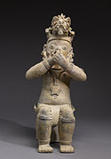 Jama-Coaque - Figure Seated on a Bench with Hands Held to Mouth - Walters 482862.jpg