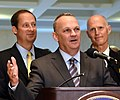 Joe Negron and Rick Scott listen as Richard Corcoran comments on successes at the end of the special session.jpg