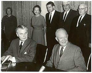 Columbia River Treaty - Canadian Prime Minister John Diefenbaker (seated left) and US President Dwight Eisenhower at the signing of the Columbia River Treaty, 1961