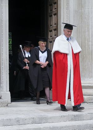 Senate House, Cambridge - Lord Eatwell, in academic dress, leaving the Senate House