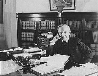 John R. McCarl - J.R. McCarl at his desk in 1935.