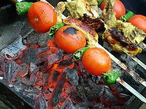 Jujeh kabab - Iranian Jūje-kabāb, grilled along tomatoes and peppers