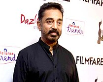 Kamal Haasan posing for the camera at the 62nd Filmfare Awards South ceremony