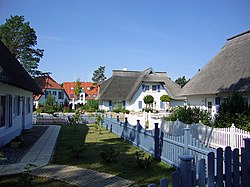 Houses with typical thatched roofs in Karlshagen (Reed houses)