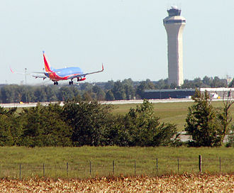 Kansas City International Airport - A Southwest Airlines Boeing 737-700 crossing a cornfield to land
