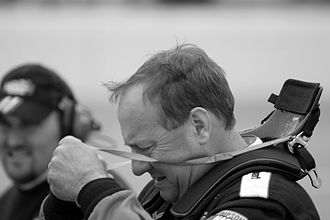 HANS device - NASCAR driver Ken Schrader wearing a HANS device