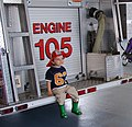 Kid on fire truck (4538276786).jpg
