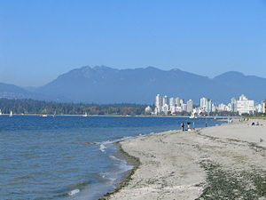 Kitsilano Beach - Kitsilano Beach with the West End, Stanley Park and the North Shore Mountains in the distance