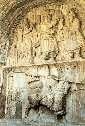 Cataphract - Relief Taq-e Bostan (Kermanshah Province in Iran) from the era of Sassanid Empire: One of the oldest depictions of a cataphract. The figure on top in the middle is believed to be Khosrau II. The figure to the right is Ahura Mazda, and to the left is the Persian Goddess Anahita. The cataphract is not known, although various theories exist on his identity, but he is certainly of royal nobility.