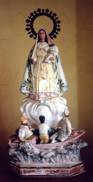 Our Lady of Charity - An antiquated image of Our Lady of Charity and her Cuban seers composed of mixed Mulatto races.
