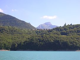 The village seen from the Lac du Sautet [fr]