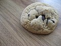 Loner chocolate chip cookie on wood-grain surface.jpg