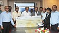 M. Veerappa Moily being presented a dividend cheque from the CMD, SJVN Limited, Shri R.P. Singh, in New Delhi on September 07, 2012. The Secretary, Ministry of Power, Shri P. Uma Shankar is also seen.jpg