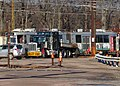 MBTA 3711 and lowboy trailer in Riverside Yard, December 2018.JPG