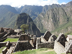 Putucusi - Putucusi (center-left) behind the ruins of Machu Picchu