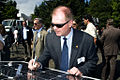 Mark Osborn signs the solar panel (6093385068).jpg