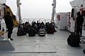 Members of the Royal Canadian Mounted Police stand watch as simulated migrants are detained aboard the survey research vessel Strait Hunter, simulating a migrant vessel, during Frontier Sentinel 2012 in Sydney 120508-N-IL267-049.jpg