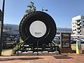 Monument of tire in front of Kurume Station.jpg