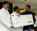 Mukul Roy presenting a Cheque of Rs. 25 lakhs to Shri Joydeep Karmakar, at a felicitation function, in New Delhi on August 17, 2012. The Minister of State for Railways, Shri Bharatsinh Solanki is also seen.jpg