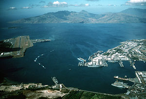 Subic Bay - Aerial view of US Naval Base Subic Bay to the right and Naval Air Station Cubi Point to the left in 1990.
